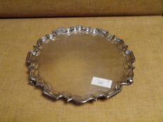 A George V silver salver, Walker & Hall, Birmingham 1917, in 18th century style, with scalloped