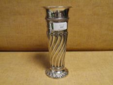 A late Victorian silver vase, London 1898, of tapering cylindrical form, with part gadrooned body