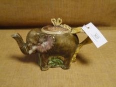 A 19th century majolica teapot, possibly Foresters, modelled with trunk spout and ribbon handle.