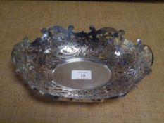 An Edwardian silver bread basket, London 1901, of oval form, elaborately pierced with foliate