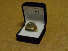 A gentleman's diamond-set 9ct gold signet ring, on fluted shoulders.