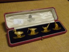 A cased set of four George V silver-gilt game bird menu card holders, Hamilton & Inches, Edinburgh