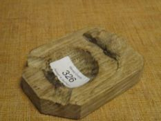 """A Robert """"Mouseman"""" Thompson oak ashtray, with carved mouse signature."""