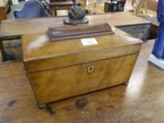 An early 19th century mahogany tea caddy, of sarcophagus form, enclosing a mixing well and twin