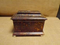 A Regency tortoiseshell tea caddy, the pagoda cover opening to reveal twin lidded compartments,