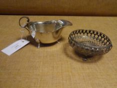 A George V silver sauce boat, London 1932; together with a George V silver bon bon dish,