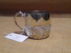 A Victorian silver christening cup, Charles Edwards, London 1885, chased with foliate scrolls. 6.6