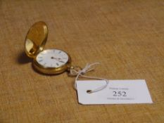 A Victorian 18ct gold lady's fob watch, the hunter case engraved to both sides with scrolls and