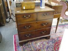 A small George III mahogany chest of drawers, the plain rectangular top over two short and two