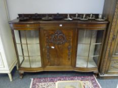 An early 20th century mahogany vitrine cabinet in the manner of Whytock & Reid, the galleried top