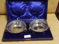 A pair of Edwardian silver sweetmeat dishes, H. Matthews, Birmingham 1907, each circular with