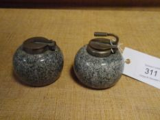 A pair of granite inkwells in the form of curling stones (a/f)