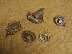 A group of three silver brooches each modelled as a ship at sail; together with an Irish silver