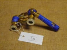 A pair of late 19th century French guilloche enamel and gilt-metal opera glasses, the handle and