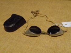A pair of 1930's motorcycle goggles, with tinted lenses, white metal and mesh frames, in a fitted