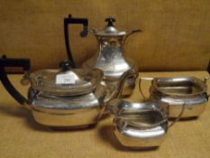 An Edwardian silver four piece tea and coffee service, Birmingham 1906, of faceted baluster form,