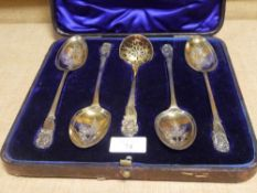 A cased set of George III Irish silver-gilt berry spoons, Dublin 1809, the four associated sifting