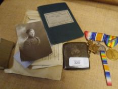 A First World War medal group: the Victory Medal with oak leaf bar, the War Medal and the 1914-15