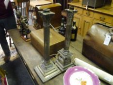 Two Corinthian columnar silver plated table lamps, one decorated to the base with Classical figures,
