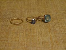Three gold rings including an 18ct gold wedding band (a/f), a zircon ring etc (3) Total gross 5.8