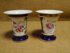 A pair of porcelain vases, c. 1830, in the manner of Coalport, each painted with a floral spray in a