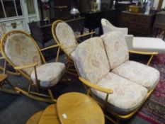 An Ercol beech three piece suite, comprising two seater sofa and a pair of rocking chairs