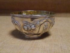 A Victorian silver sugar bowl, Chawner & Co., London 1870, repousse with figural and rococo