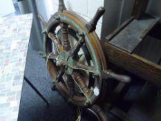A brass mounted oak ship's wheel, Mactaggart Scott, Edinburgh, later converted to a ceiling light