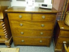 A George III mahogany chest of drawers, the rectangular top over two short and three long drawers.