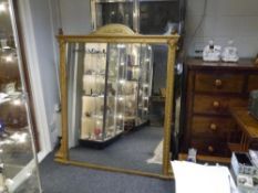 A 19th century gilt composition overmantel mirror, the rectangular plate within a frame moulded with