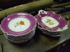 A mid-19th century porcelain dessert service, painted with floral sprays within puce and gilt