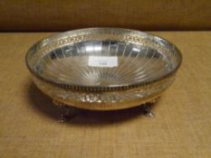 A George V silver footed bowl, Birmingham 1934, with pierced rim and raised on pad feet. Diameter
