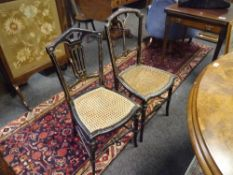 A pair of Victorian mother of pearl inlaid ebonised drawing room chairs, each with cane seat.