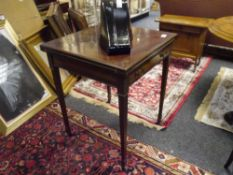 An Edwardian mahogany envelope card table, of characteristic form, fitted with a frieze drawer,