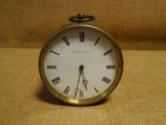 A late 19th century French brass drumhead desk clock, the white enamel dial with Roman numerals