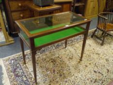 A George III style inlaid mahogany bijouterie table, decorated throughout with string inlay, the