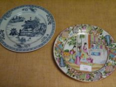 A Canton porcelain plate, 19th century, painted with ladies in a garden within a border of
