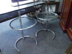 A pair of chromium plated and glass occasional tables in the Art Deco taste. 72cm by 51cm