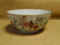 A Chinese porcelain punch bowl, painted in famille rose enamels with Precious Objects (rim chip