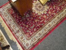 A Kashmir rug of Shahbaz type with a red ground. 1.70m by 1.20m