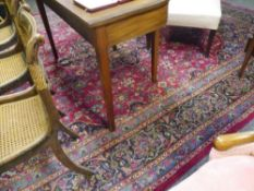 A hand woven Persian Kashan carpet, with multi-coloured medallions. 2.89m by 2.84m