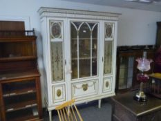 A Continental painted and parcel gilt vitrine cabinet in the Neoclassical taste, c. 1900, with