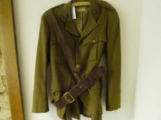 A World War II Royal Scots Fusiliers officer's khaki jacket, with lapel badges and brass buttons,