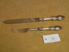 A mid-Victorian silver cake knife and fork, Birmingham 1861 and 1862, with silver blade and tines,