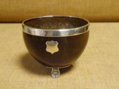 An early 19th century silver (unmarked) mounted coconut bowl, the rim with inscription dated 1866,