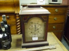 An early 20th century mahogany cased bracket clock, the case with caddy top and raised on bracket