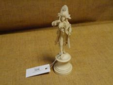 """A late 19th century French ivory figure of an """"Incroyable"""", the dandy modelled in bicorn hat and"""