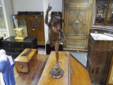 A 19th century patinated bronze figure of Mercury, in characteristic pose, on an integral circular