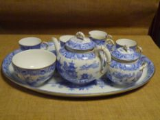 A Royal Worcester porcelain cabaret set in the Willow pattern, factory mark for 1902, comprising