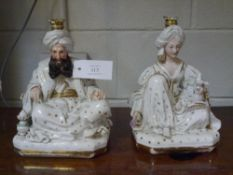 A pair of Jacob Petit porcelain figural scent bottles, c. 1870, modelled as seated Turkish